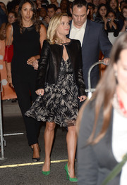 Reese Witherspoon kept warm in chic style with a black leather jacket at the premiere of 'The Devil's Knot.'