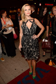 Reese Witherspoon showed some cleavage in a chic Jason Wu print dress at the premiere of 'The Devil's Knot.'