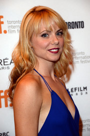 Collette Wolfe styled her locks in a lovely wavy 'do with choppy bangs for the premiere of 'The Devil's Knot.'
