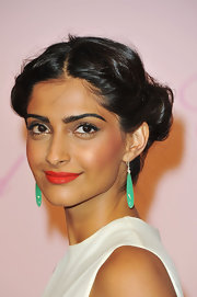 Sonam was certainly a darling of the 2011 Cannes Film Festival. At the Chopard party, the Bollywood beauty offset her white gown with green chrysoprase drop earrings accented with chrysoprase briolettes and diamonds.