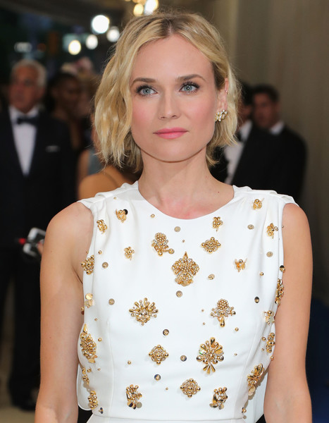 Diane Kruger Short Wavy Cut [rei kawakubo/comme des garcons: art of the in-between,rei kawakubo/comme des garcons: art of the in-between,hair,hairstyle,blond,clothing,fashion model,lip,fashion,beauty,eyebrow,long hair,costume institute gala - arrivals,diane kruger,new york city,metropolitan museum of art,costume institute gala]