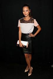 Jamie added some edge to her look with a black leather skirt.