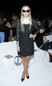 Harley Viera-Newton went for a demure look with a black-and-white lace cocktail dress when she attended the Diane Von Furstenberg fashion show.