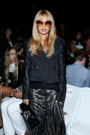 Rachel Zoe amped up the edge factor with a Givenchy bulldog clutch and a leather jacket at the Diane Von Furstenberg fashion show.