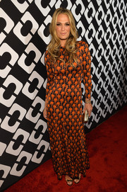 Molly Sims flaunted her svelte physique in a body-con DVF print dress during the Journey of a Dress exhibition opening.