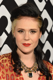 Kate Nash styled her locks into a retro-chic half-up 'do for the Journey of a Dress exhibition opening.