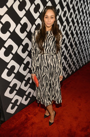 Cara Santana was classic and chic in a long-sleeve zebra-print dress during the Journey of a Dress exhibition opening.
