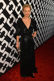 Elizabeth Gilpin dazzled in a sequined black wrap gown at the Journey of a Dress exhibition opening.