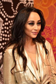 Cara Santana left her long wavy locks loose when she attended the Diane von Furstenberg presentation.