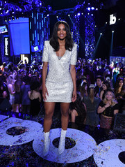 Ciara sealed off her look with a pair of lace-up boots that were an exact match to her frock!