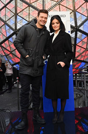 Lucy Hale bundled up in a belted black wool coat for the Dick Clark's New Year's Rockin' Eve press junket.