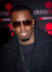 Sean Combs accessorized with a classic pair of Carrera aviators during the 'Coming Home' signing.