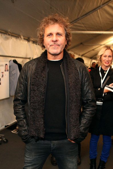 Renzo Rosso's black leather jacket and knit scarf were a handsome and cozy pairing.
