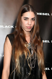 Amber Le Bon had her ombre locks lightly curled for the Diesel Black Gold fashion show.