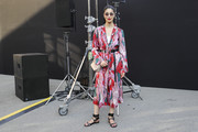 Caroline Issa teamed her frock with flat, ankle-wrap sandals.