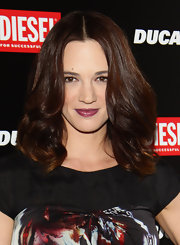 Asia Argento opted for a plum shade of lipstick at the Ducati and Diesel party.