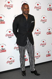 Tyson Beckford spiced up his evening look with black and white striped pants.