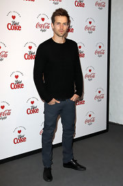 Andrew Cooper opted for a black crew neck knit sweater for his classically preppy look at the Marc Jacobs and Diet Coke Launch.