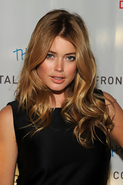 Doutzen Kroes showed off her long curls while hitting an event in New York city.
