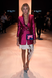 Nina Suess looked smart and chic in a fitted magenta jacket paired with a white mini skirt at the Dimitri fashion show.