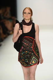 Barbara Meier wore a Dmitri beaded mini dress down the runway during Mercedes Benz Fashion Week.