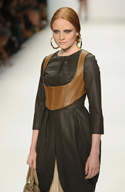 Drama was in the air as Barbara Meier modeled a Dimitri black leather dress during Fashion Week in Berlin.