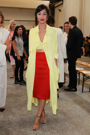 Nicole Warne showed off her mixing-and-matching and color-combining prowess with this yellow Michael Lo Sordo coat, crop-top, and red pencil skirt ensemble at the Dion Lee show.