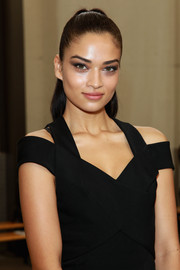 Shanina Shaik styled her hair in a sleek pony for the Dion Lee fashion show.