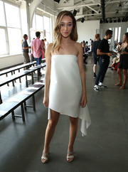 Alycia Debnam-Carey showed some skin in a strapless, asymmetrical-hem LWD at the Dion Lee fashion show.