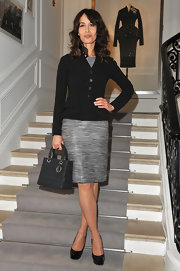 Dolores Chaplin topped off her look with black patent leather platform pumps.