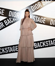 Bella Hadid looked enchanting in a tiered nude gown by Dior Couture at the Dior Backstage launch party in Seoul.