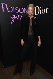 Toni Garrn donned a black velvet blazer for a bit of modesty to her completely sheer top at the NY Poison Club event.