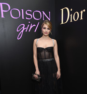 Dianna Agron made an appearance at the NY Poison Club event carrying an edgy-chic beaded purse by Dior.