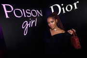 Keke Palmer showed off a studded red tote by Dior at the NY Poison Club event.