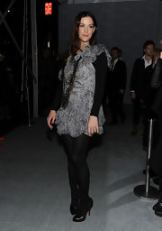 Liv Tyler paired a unique layered look with Louboutin ankle boots. She wore the peep toe boots with opaque tights for a sleek look.
