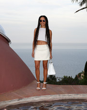 Zoe Kravitz completed her skin-baring ensemble with a white Dior Couture mini skirt.