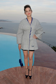 Marion Cotillard wrapped up her figure in a boxy gray Dior Couture wool coat for the brand's Croisiere show.