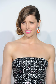 Jessica Biel accessorized with David Webb dangling hoops in orange, silver, and black that contrasted beautifully with her pink lips.