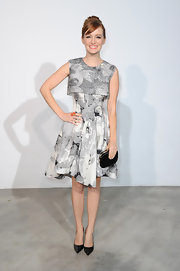 Ahna O'Reilly's gray print dress for a classic lady-like look at the Dior Cruise Collection presentation.