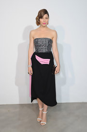 Jessica Biel wore this black, pink, and white houndstooth bustier and draped black skirt that featured a pastel pink draped insert.