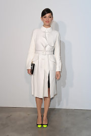 Marion looked nothing short of gorgeous in this white trench that featured ruffle detailing and a belted waist.