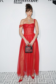 Bella Hadid matched her dress with a pair of red patent pumps.