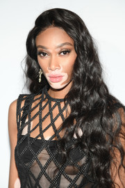 Winnie Harlow wore her long hair loose in a curly style at the Dior dinner during Cannes.