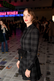 Maya Hawke attended the Dior Fall 2020 show sporting a black leather belt bag from the brand.