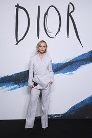 Christina Ricci styled her look with a crescent-shaped mirrored clutch.
