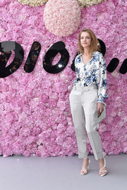 Natalia Vodianova polished off her look with a pair of strappy white heels.