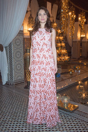Olga Kurylenko oozed girly charm in an embroidered pink and red A-line gown by Christian Dior while attending the French fashion house's dinner at the Marrakech International Film Festival.