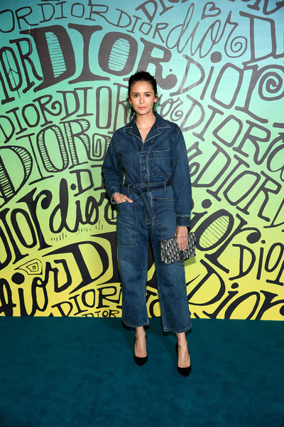 Nina Dobrev was casual and edgy in a denim jumpsuit at the Dior Men Fall 2020 show.