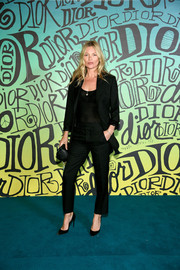 Kate Moss looked simply stylish in a black pantsuit at the Dior Men Fall 2020 show.