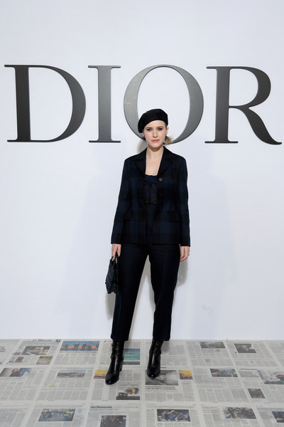 Rachel Brosnahan attended the Dior Fall 2020 show wearing a dark checkered pantsuit.